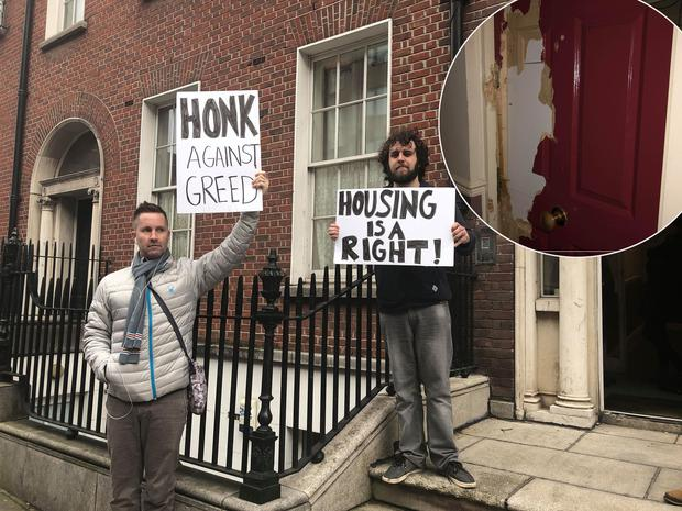 Protesters outside the apartment on Mountjoy Square and inset, the damage done to the door of the apartment