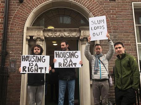 Protesters outside the apartment building in Mountjoy Square
