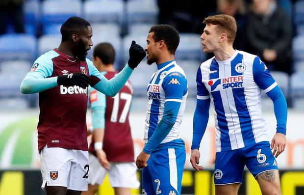 West Ham United's Arthur Masuaku clashes with Wigan Athletic's Max Power (R) before being sent off