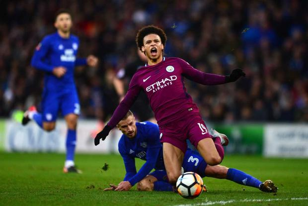 Leroy Sane of Manchester City is tackled by Joe Bennett of Cardiff City during The Emirates FA Cup Fourth Round between Cardiff City and Manchester City on January 28, 2018 in Cardiff, United Kingdom. (Photo by Harry Trump/Getty Images)
