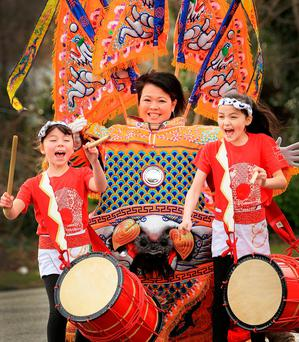Evan Furlong, from Taiwan, with Japanese taiko drummers Laoise O'Connor and Hanako O'Donnell at the Holiday World Show at the RDS. Photo: Gerry Mooney