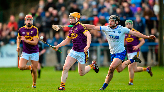 Simon Donohoe of Wexford in action against Jake Dillon of Waterford. Photo by Matt Browne/Sportsfile