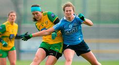 Donegal's Emer Gallagher gets her shot away despite the close attention of Dublin's Sarah McCaffrey yesterday. Photo: Oliver McVeigh/Sportsfile