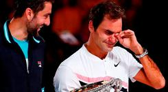 An emotional Roger Federer after his Australian Open victory over Marin Cilic (l). Photo: Michael Dodge/Getty Images