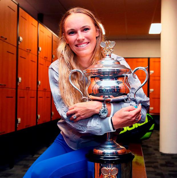 Caroline Wozniacki of Denmark poses with the Daphne Akhurst Trophy. Photo: Clive Brunskill/Getty Images