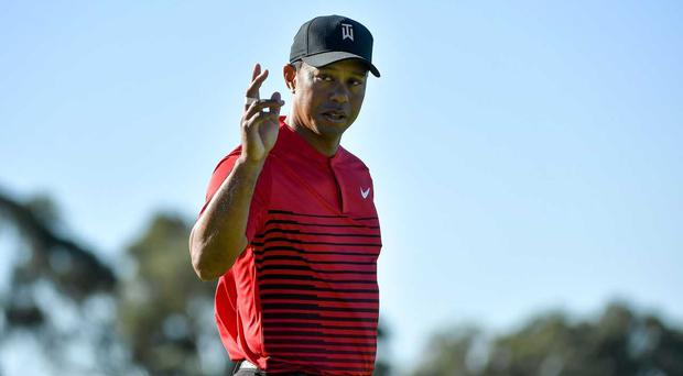 Tiger Woods motions to the crowd after a putt on the 14th green during the final round of the Farmers Insurance Open at Torrey Pines South on January 28, 2018 in San Diego, California. (Photo by Donald Miralle/Getty Images)