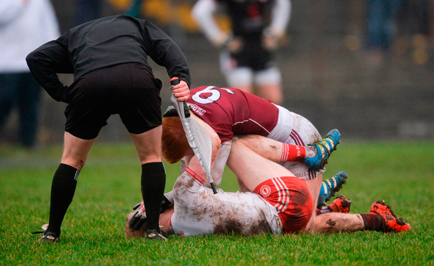 Peter Cooke of Galway and Hugh Pat McGeary of Tyrone tussle. Photo by Piaras Ó Mídheach/Sportsfile