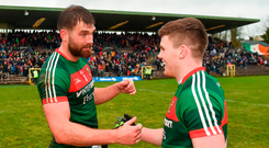 Mayo captain Aidan O'Shea congratulates team-mate Eoin O'Donoghue after the game. Photo by Seb Daly/Sportsfile