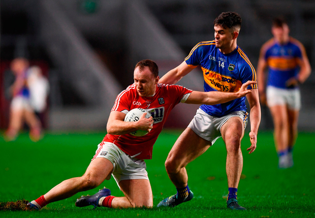 Brian O'Driscoll of Cork in action against Michael Quinlivan of Tipperary. Photo by Stephen McCarthy/Sportsfile