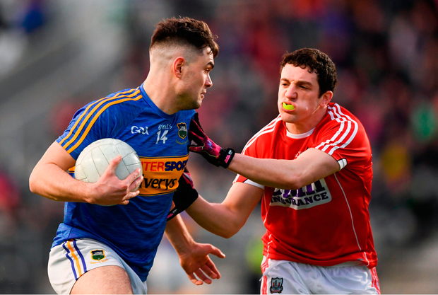 Michael Quinlivan of Tipperary in action against Micheal McSweeney of Cork. Photo by Stephen McCarthy/Sportsfile