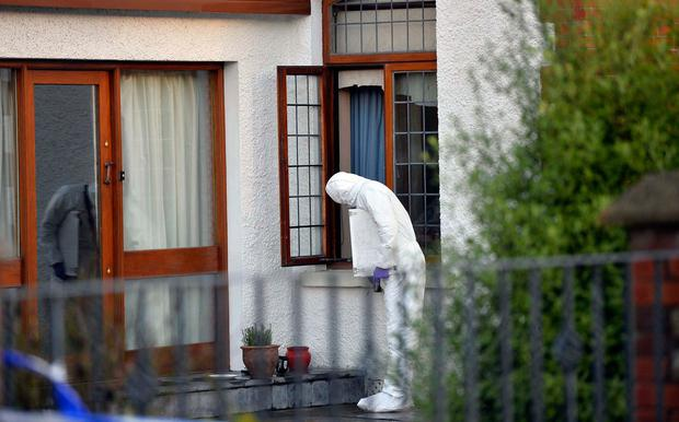Forensic police investigate the burglary at the elderly woman's house in Aughnacloy, Co Tyrone. Photo: Pacemaker