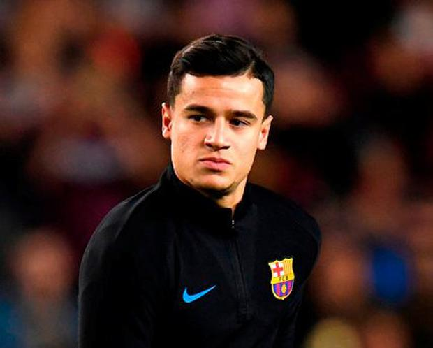 Philippe Coutinho warms up before making his La Liga debut for Barcelona last night. Photo: David Ramos/Getty Images