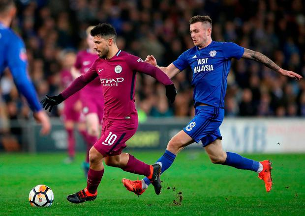 Manchester City's Sergio Aguero and Cardiff City's Joe Ralls in action. Photo: Nick Potts/PA Wire