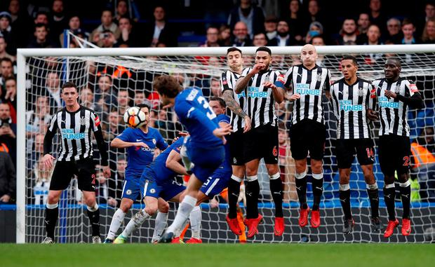 Chelsea's Marcos Alonso scores their third goal from a free kick. Photo: Eddie Keogh/Reuters