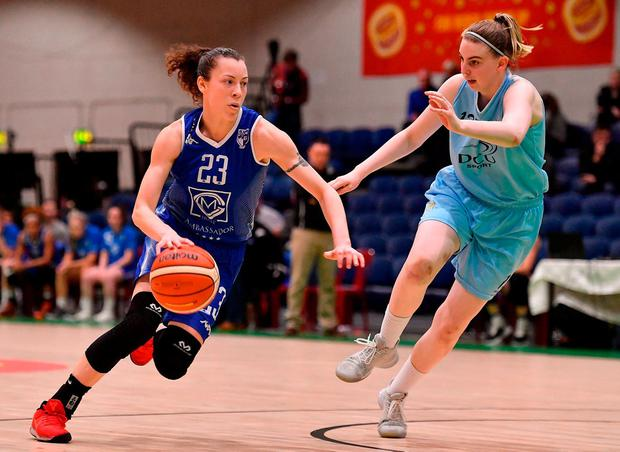 Adily Martucci of Ambassador UCC Glanmire in action against Bronagh Cassidy-Power of DCU Mercy. Photo: Brendan Moran/Sportsfile