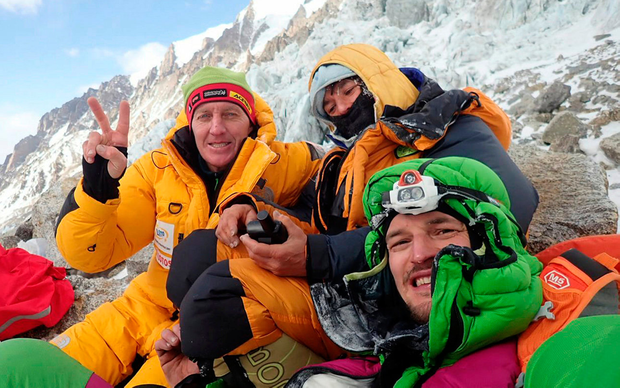 Climber Elisabeth Revol (centre) with some of the rescue team at the base of Nanga Parbat, Pakistan yesterday Photo: Reuters