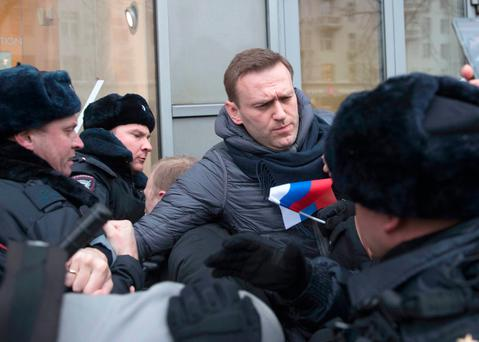 Russian opposition leader Alexei Navalny is arrested during protests against Vladimir Putin's 20-year rule Photo: AP