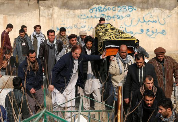 Afghan men carry the coffin of one of the victims of yesterday's car bomb attack in Kabul Photo: REUTERS/Omar Sobhani