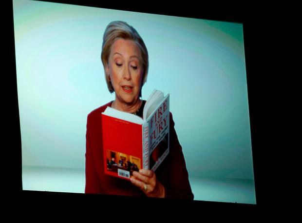 Hillary Clinton appears on screen reading an excerpt from the book