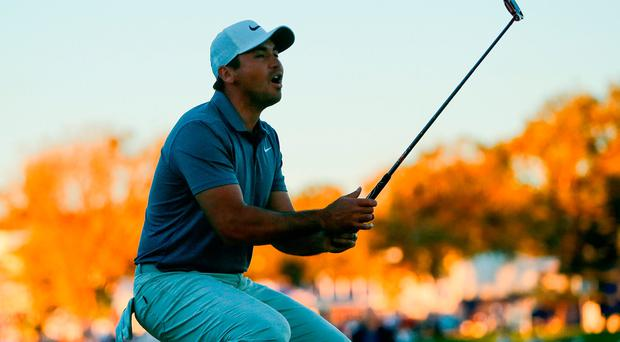Jason Day of Australia reacts after missing a putt on the 16th hole