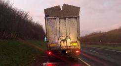Two of the bales fell onto the carriageway, one of them landing on the bonnet of a car. Images: Meath Crime Prevention.