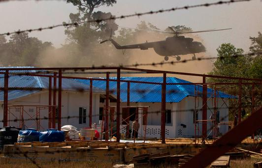 A helicopter carrying an advisory commission including former New Mexico Gov. Bill Richardson lands near a newly-built repatriation camps prepared for Rohingya refugees expected to return from Bangladesh, Wednesday, Jan. 24, 2018, in Taungpyo township, a border town of northern Rakhine State, Myanmar. (AP Photo/Thein Zaw)