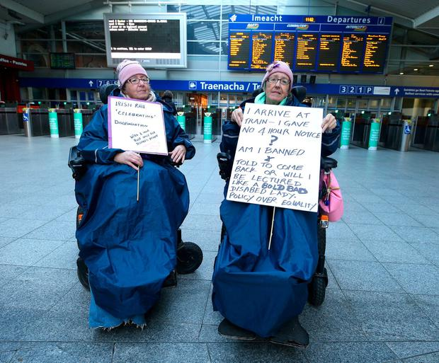 Twins, Margaret Kennedy, 65, and Ann Kennedy, 65, from Greystones, protest before the launch of the DART Improved Accessibility Pilot at Connolly Station. Picture credit; Damien Eagers