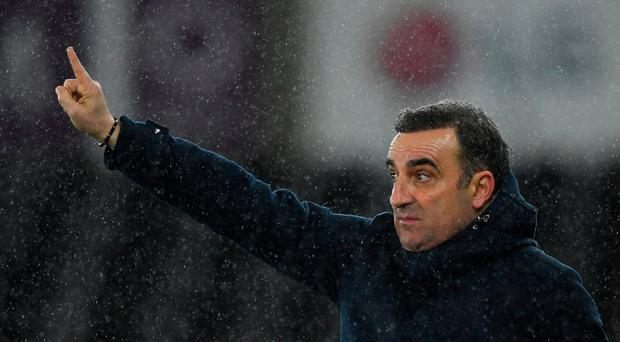 Carlos Carvalhal is hopeful of keeping Swansea in the Premier League Photo: Getty