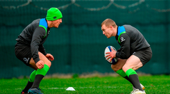 Ian Keatley lines up the tackle on Keith Earls during Ireland's training session at Carton House yesterday. Photo: Sportsfile