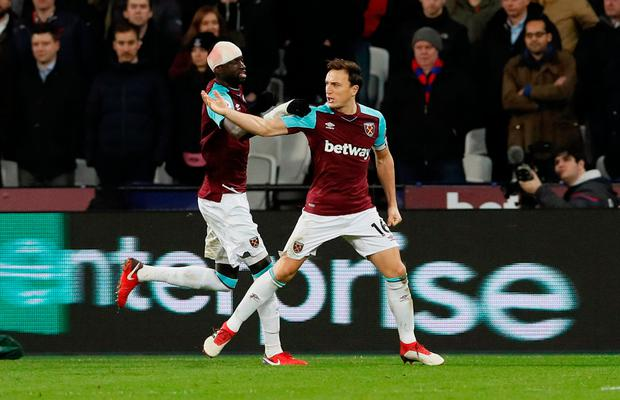 West Ham United's Mark Noble celebrates with Cheikhou Kouyate after scoring the penalty. Photo: Reuters