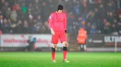 A dejected Petr Cech leaves the pitch. Photo: PA