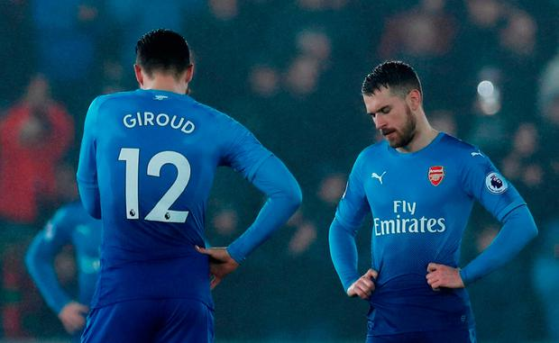 Arsenal's Olivier Giroud and Aaron Ramsey look dismayed after Swansea City's third goal. Photo: Reuters