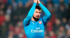 Olivier Giroud acknowledges the travelling Arsenal support after their 3-1 defeat to Swansea. Photo: PA