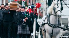 The remains are carried to church at the funeral of of Derek Coakley Hutch this morning at Our Lady of Lourdes Church, Sean McDermott Street Picture: Collins Dublin