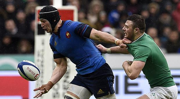 French flanker Wenceslas Lauret holds off Robbie Henshaw during Ireland's last trip to Paris, which ended in defeat. Photo: Franck Fife