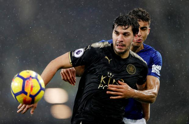 Leicester City's Aleksandar Dragovic in action with Everton's Dominic Calvert-Lewin. Photo: Reuters
