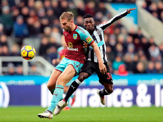 Burnley's Charlie Taylor (left) and Newcastle United's Christian Atsu battle for the ball. Photo: Owen Humphreys/PA Wire