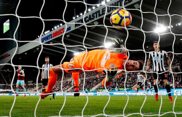 Burnley's Sam Vokes scores their first goal as Newcastle United's Karl Darlow attempts to save. Photo: Lee Smith/Action Images via Reuters