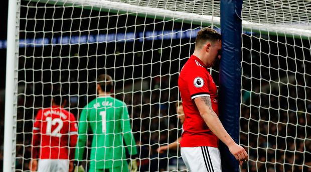 Phil Jones reacts after scoring an own goal to give Tottenham a 2-0 lead against Manchester United. Photo: Adrian Dennis/AFP