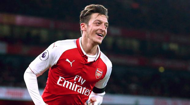 Ozil: Set to sign new contract. Photo: PA Wire