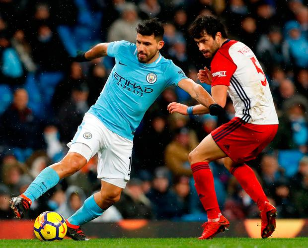 Manchester City's Sergio Aguero (left) and West Bromwich Albion's Claudio Yacob battle for the ball. Photo: Martin Rickett/PA Wire