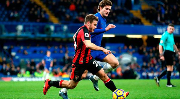 AFC Bournemouth's Ryan Fraser (left) and Chelsea's Marcos Alonso (right) battle for the ball. Photo: Nigel French/PA Wire