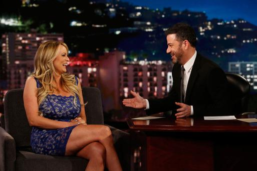 Porn star Stormy Daniels laughs with host Jimmy Kimmel during an appearance on his ABC chat show. Photo: Randy Holmes/AP