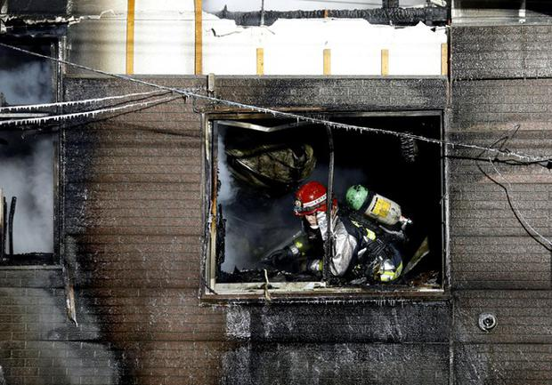A firefighter inspects a facility to support senior people on welfare, where a fire occurred, in Sapporo, Japan, in this photo taken by Kyodo on February 1, 2018