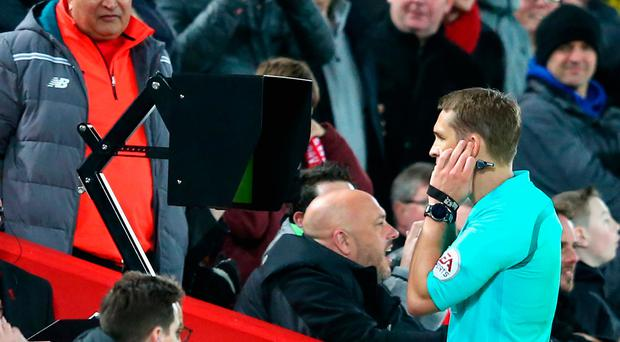 LIVERPOOL, ENGLAND - JANUARY 27: Craig Pawson, match referee, watches the VAR screen before awarding a penalty to Liverpool during The Emirates FA Cup Fourth Round match between Liverpool and West Bromwich Albion at Anfield on January 27, 2018 in Liverpool, England. (Photo by Alex Livesey/Getty Images)