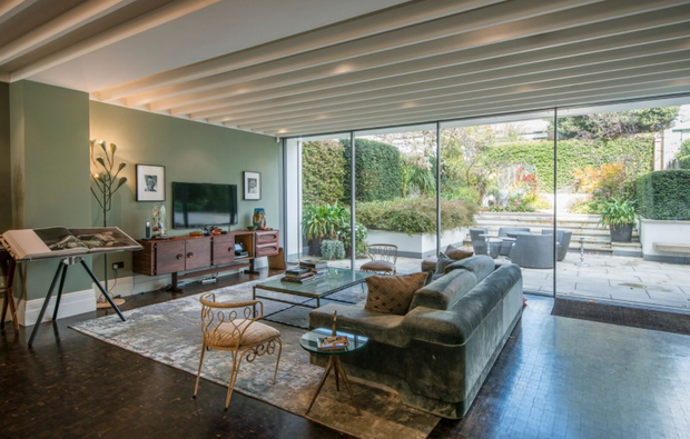 The spacious family room offers views of the landscaped garden. Photo: Aston Chase