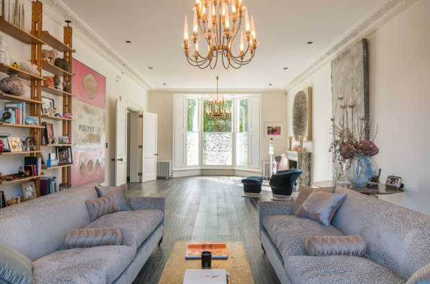 The formal reception room has high ceilings and the townhouse's original period fireplace. Photo: Aston Chase