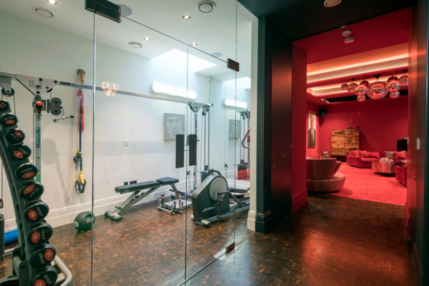 The basement features a gym, guest bedroom and cinema room. Photo: Aston Chase
