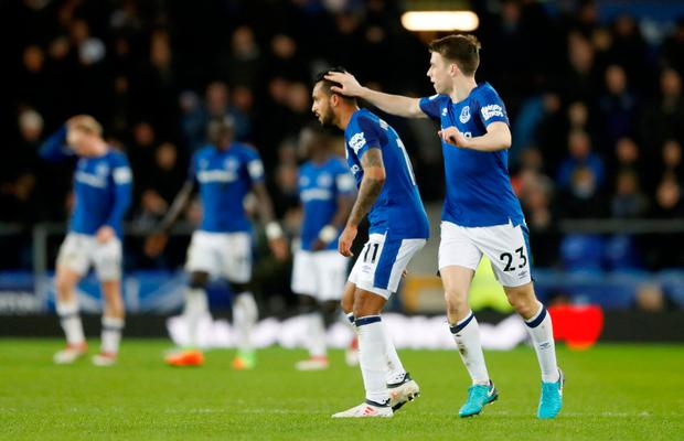 Everton's Theo Walcott celebrates scoring their second goal with Seamus Coleman