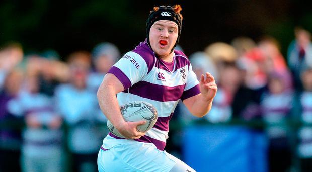Rossa O'Kane of Clongowes Wood College on his way to scoring a second half try